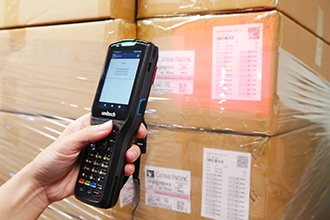 The Unitech HT380 in a Warehouse